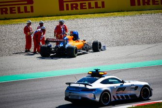 Safety Car drives past the car of Lando Norris, McLaren MCL34 being recovered by marshals