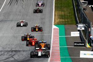 Kimi Raikkonen, Alfa Romeo Racing C38, leads Lando Norris, McLaren MCL34, Sebastian Vettel, Ferrari SF90, Max Verstappen, Red Bull Racing RB15, and Pierre Gasly, Red Bull Racing RB15