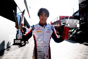 Nobuharu Matsushita, Carlin, celebrates with his trophy after winning the race