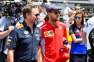 Christian Horner, Team Principal, Red Bull Racing, with Sebastian Vettel, Ferrari