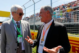Marc Garneau, Canadian Minister of Transport, with Chase Carey, Chairman, Formula 1