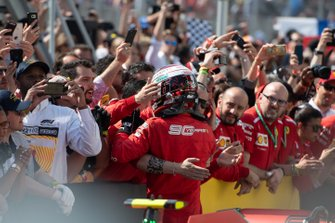 Charles Leclerc, Ferrari, 3rd position, celebrates in Parc Ferme with his team