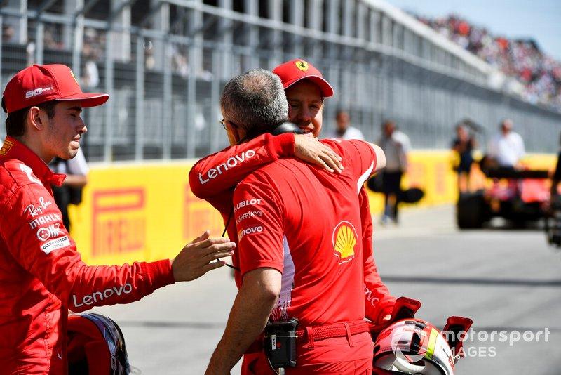 Charles Leclerc, Ferrari, and pole man Sebastian Vettel, Ferrari, celebrate with a colleague from Ferrari after Qualifying