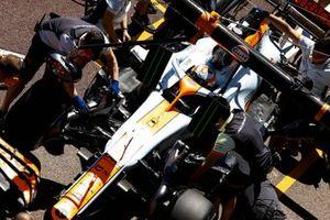Lando Norris, McLaren MCL35M, in the pit lane