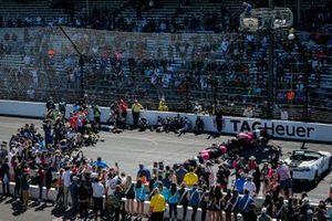 Helio Castroneves, Meyer Shank Racing Honda celebrates his victory, kissing the bricks