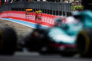Sebastian Vettel, Aston Martin AMR21, approaches his pit board