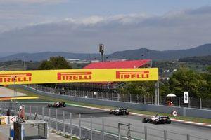 Kimi Raikkonen, Alfa Romeo Racing C41, Mick Schumacher, Haas VF-21, and Nikita Mazepin, Haas VF-21