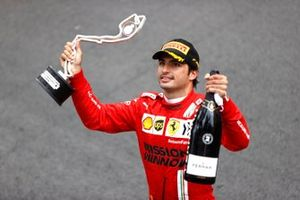 Carlos Sainz Jr., Ferrari, 2nd position, with his trophy and Champagne