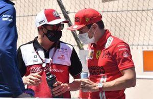 Kimi Raikkonen, Alfa Romeo Racing, and Charles Leclerc, Ferrari, in the drivers parade