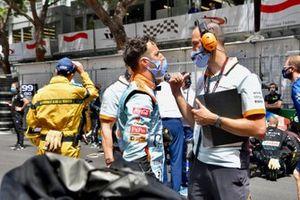 Daniel Ricciardo, McLaren, talks with his engineer