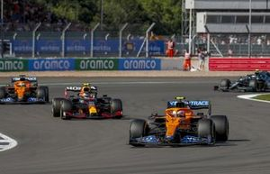 Lando Norris, McLaren MCL35M, Sergio Perez, Red Bull Racing RB16B, and Daniel Ricciardo, McLaren MCL35M