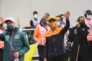 Sebastian Vettel, Aston Martin, and Lando Norris, McLaren, at the drivers parade