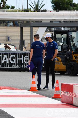 Nicholas Latifi, Williams, walks the track with a team mate
