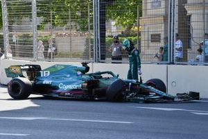 Lance Stroll, Aston Martin AMR21, walks away from his car after hitting the wall