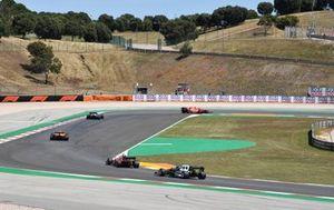 Carlos Sainz Jr., Ferrari SF21, Esteban Ocon, Alpine A521, Lando Norris, McLaren MCL35M, Charles Leclerc, Ferrari SF21, and Pierre Gasly, AlphaTauri AT02