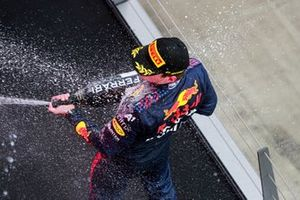 Max Verstappen, Red Bull Racing, 1st position, celebrates on the podium with Champagne
