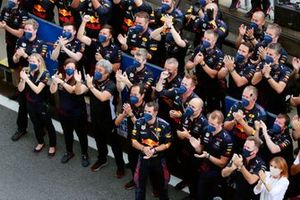The Red Bull team cheer for their driver Max Verstappen, Red Bull Racing, 1st position, on the podium