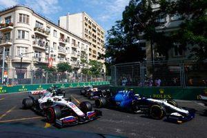 Nicholas Latifi, Williams FW43B, battles with Mick Schumacher, Haas VF-21, on the opening lap