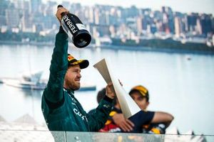 Sebastian Vettel, Aston Martin, 2nd position, with his trophy and Champagne