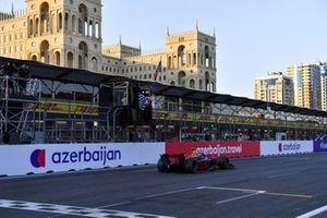 Juri Vips, Hitech Grand Prix, passes the chequered flag