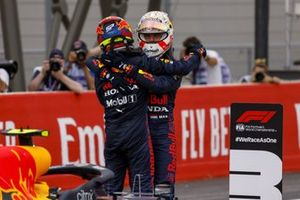 Sergio Perez, Red Bull Racing, 3rd position, and Max Verstappen, Red Bull Racing, 1st position, celebrate in Parc Ferme