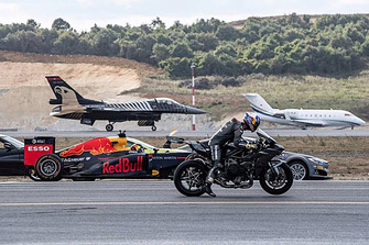 Tesla races Formula 1 car and fighter jet and motorcycle