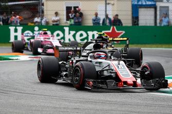 Romain Grosjean, Haas F1 Team VF-18, leads Carlos Sainz Jr., Renault Sport F1 Team R.S. 18, and Esteban Ocon, Racing Point Force India VJM11
