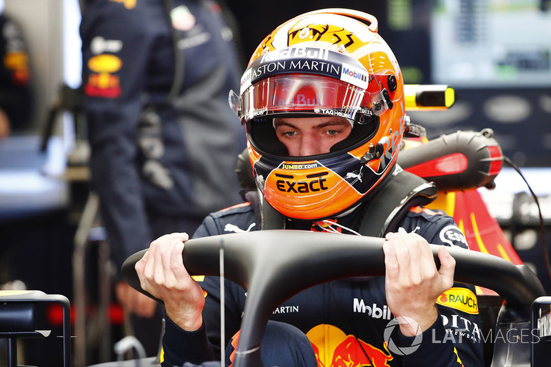 Max Verstappen, Red Bull Racing, enters his cockpit