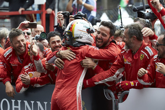 Sebastian Vettel, Ferrari, 1st position, celebrates with his team in Parc Ferme