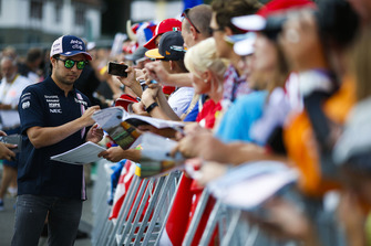 Sergio Perez, Force India, signs autographs for fans