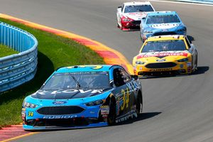 Michael McDowell, Front Row Motorsports, Ford Fusion K-LOVE RADIO and Clint Bowyer, Stewart-Haas Racing, Ford Fusion Rush Truck Centers