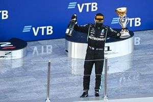 Valtteri Bottas, Mercedes-AMG F1, 1st position, on the trophy with his trophy and Champagne