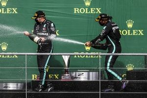 Lewis Hamilton, Mercedes-AMG F1, 1st position, sprays Valtteri Bottas, Mercedes-AMG F1, 2nd position, with Champagne on the podium