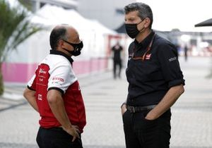 Frederic Vasseur, Team Principal, Alfa Romeo Racing speaks with Guenther Steiner, Team Principal, Haas F1