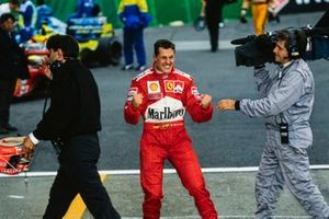 Michael Schumacher celebrates securing his third world drivers' championship title