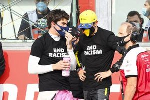 Lance Stroll, Racing Point, and Esteban Ocon, Renault F1, on the grid