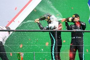 Peter Bonnington, Race Engineer, Mercedes AMG, Lewis Hamilton, Mercedes-AMG F1, 1st position, and Valtteri Bottas, Mercedes-AMG F1, 2nd position, spray Champagne on the podium