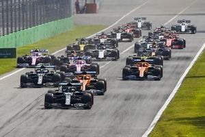 Lewis Hamilton, Mercedes F1 W11 Carlos Sainz Jr., McLaren MCL35, Valtteri Bottas, Mercedes F1 W11 and Lando Norris, McLaren MCL35 at the start of the race