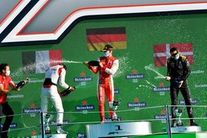 Race Winner Mick Schumacher, Prema Racing, Luca Ghiotto, Hitech Grand Prix, 2nd position, and Christian Lundgaard, ART Grand Prix, 3rd position, celebrate on the podium with the champagne