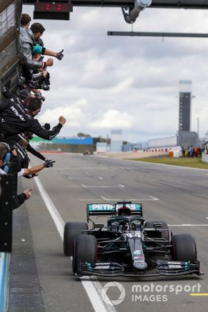 Lewis Hamilton, Mercedes F1 W11, 1st position, crosses the line to the delight of his team