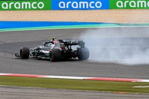 Valtteri Bottas, Mercedes F1 W11, pulls aside with smoke