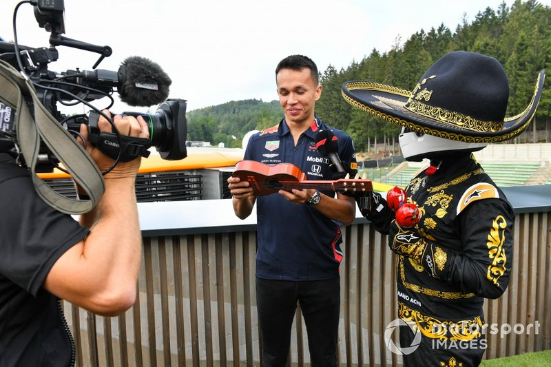 Alexander Albon, Red Bull, is presented with a musical instrument