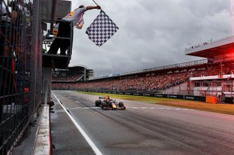 Max Verstappen, Red Bull Racing RB15, 1st position, takes the chequered flag