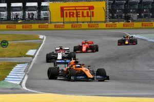 Carlos Sainz Jr., McLaren MCL34, leads Kimi Raikkonen, Alfa Romeo Racing C38, Sebastian Vettel, Ferrari SF90, and Pierre Gasly, Red Bull Racing RB15