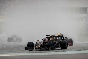 Romain Grosjean, Haas F1 Team VF-19, leads Pierre Gasly, Red Bull Racing RB15