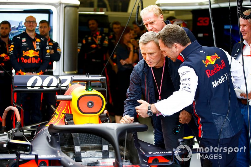 Daniel Craig, Actor with Christian Horner, Team Principal, Red Bull Racing in the Red Bull Racing Garage