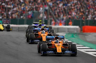 Carlos Sainz Jr., McLaren MCL34, leads Lando Norris, McLaren MCL34, and Alexander Albon, Toro Rosso STR14