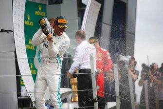 Lewis Hamilton, Mercedes AMG F1, 1st position, sprays Champagne from the podium