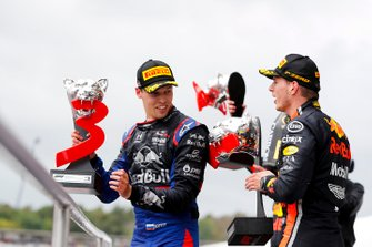 Daniil Kvyat, Toro Rosso, 3rd position, and Max Verstappen, Red Bull Racing, 1st position, on the podium with their trophies