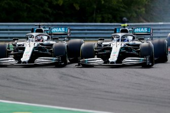 Lewis Hamilton, Mercedes AMG F1 W10, battles with Valtteri Bottas, Mercedes AMG W10, at the start